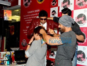 Varun Dhawan & John Abraham promote 'Dishoom' at Fever 104 FM