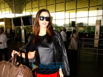 Amy Jackson & Sushant Singh Rajput snapped at the airport