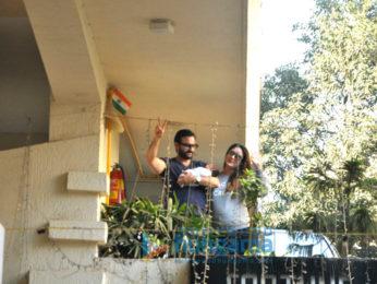 Saif Ali Khan and Kareena Kapoor Khan pose with baby Taimur outside their residence