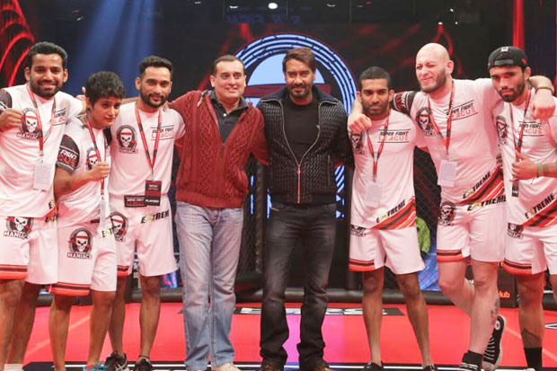 Ajay Devgn poses with his team at the inauguration of Super Fight League