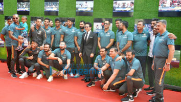 Anushka Sharma and cricketer Virat Kohli pose with Sachin Tendulkar at the premiere of Sachin A Billion Dreams