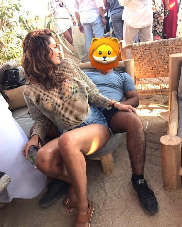 OMG! Who's this 'ugly face' sitting so close to Esha Gupta