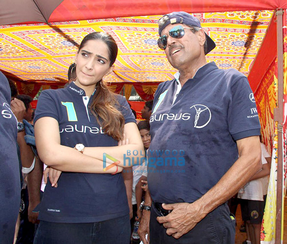 Sonam Kapoor and Kapil Dev at an event held by Magic Bus in Dharavi