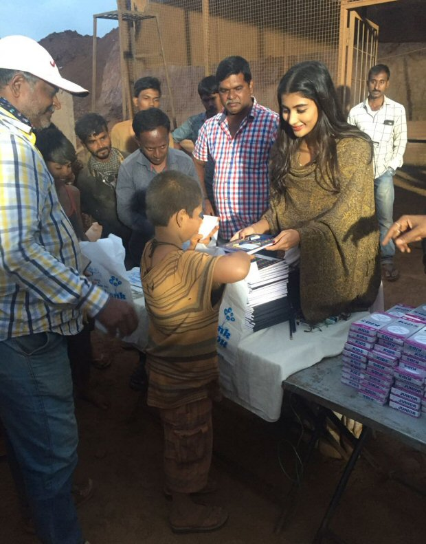 Check out Pooja Hegde distributes books to 100 kids on the sets of her next Telugu film!