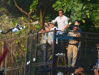 Shah Rukh Khan waves to fans from Mannat on his 52nd birthday