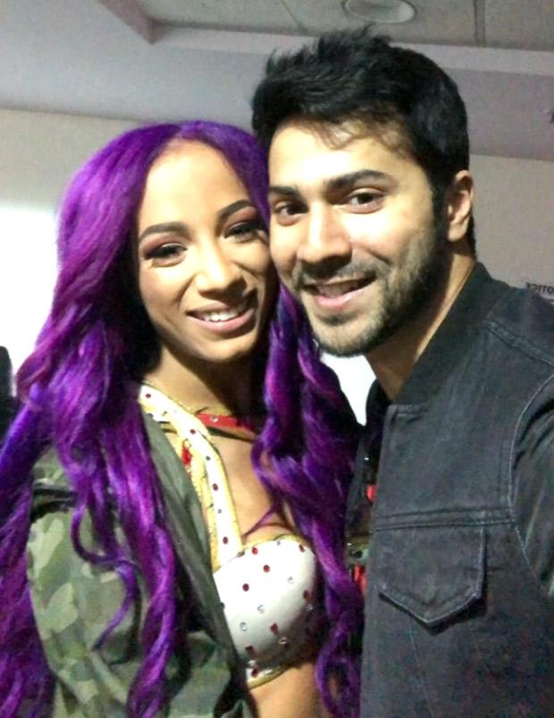 WATCH-Varun-Dhawan-meets-WWE-superstars-Jindar-Mahar,-Sasha-Banks-and-Triple-H-in-New-Delhi-(1)