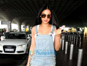 Sonal Chauhan and Badshah snapped at theb airport