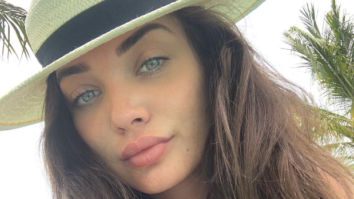 Amy Jackson flaunts her baby bump while enjoying miniature golf