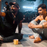 Remo D'souza and a shirtless Varun Dhawan look lost in an intense discussion in this behind-the-scenes picture from Street Dancer 3D
