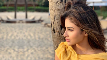 SUMMER SIZZLE Mouni Roy dips her toes in sand wearing a sexy bralette, reminisces about the latest GOT episode
