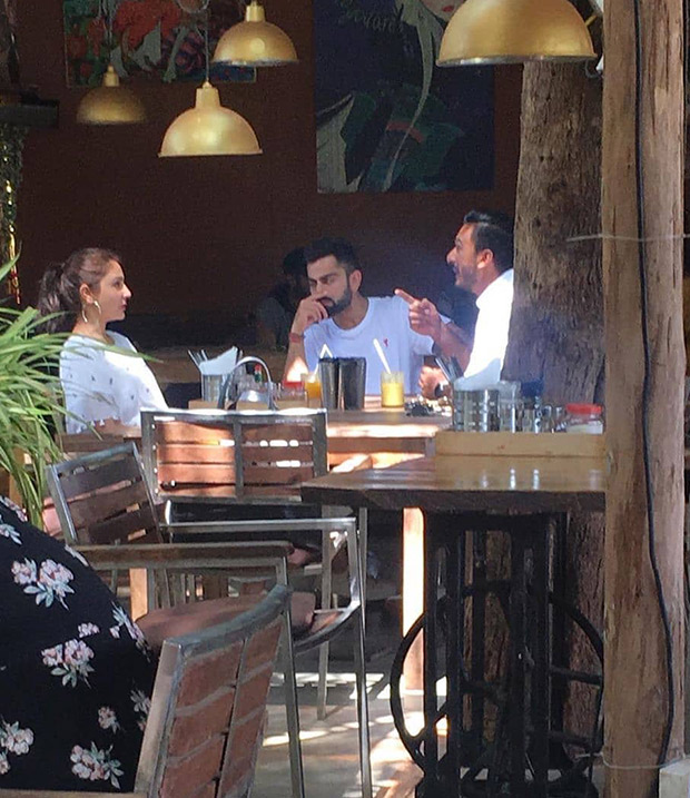 Anushka Sharma - Virat Kohli chill in Goa and this photo of them at a restaurant is going VIRAL on every fan page!