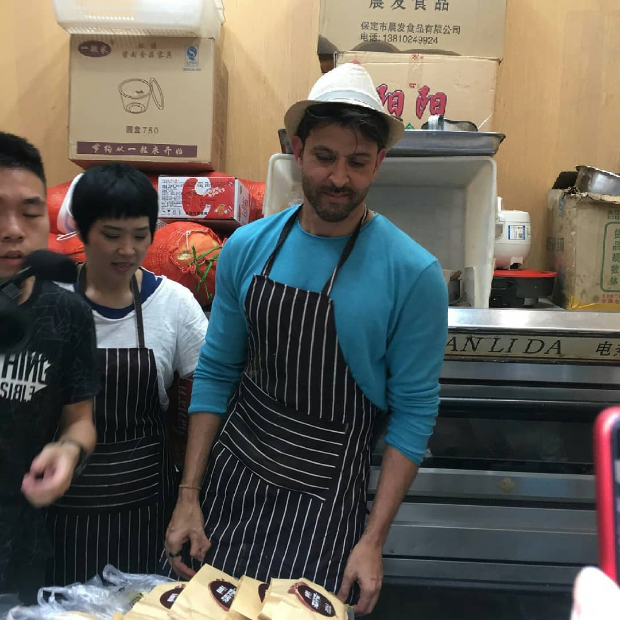 WATCH: Hrithik Roshan makes wheat noodles, serves food to fans at a local restaurant in China