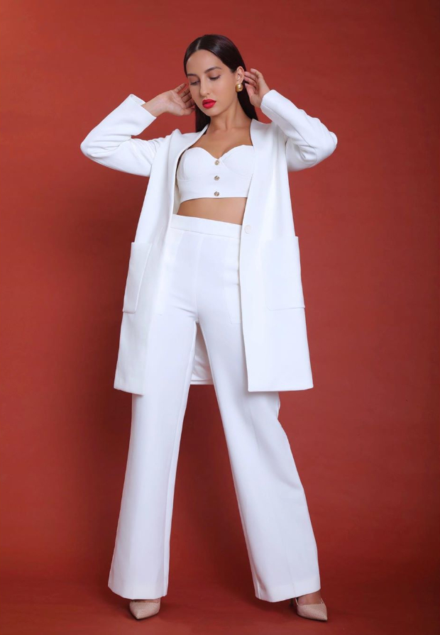 Boss babe Nora Fatehi is a vision in white in this all white ensemble at Batla House trailer launch
