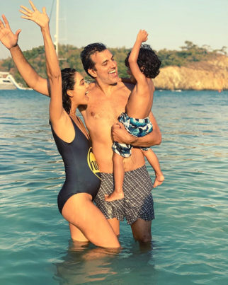 PARTY OF FOUR! Lisa Haydon announces her second pregnancy with an adorable photo with husband and son