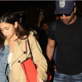 Ranbir Kapoor safely escorts Alia Bhatt from the crowd gathered at the airport