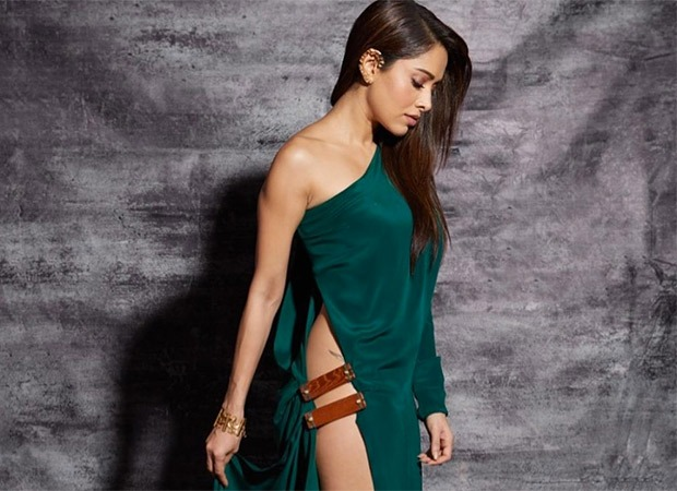 HOT ALERT - Nushrat Bharucha's flirtatious and tantalizing outfit is worth carrying a torch for!