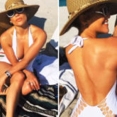 Jennifer Lopez soaks under the Miami sun flaunting her toned body in white halter-neck swimsuit