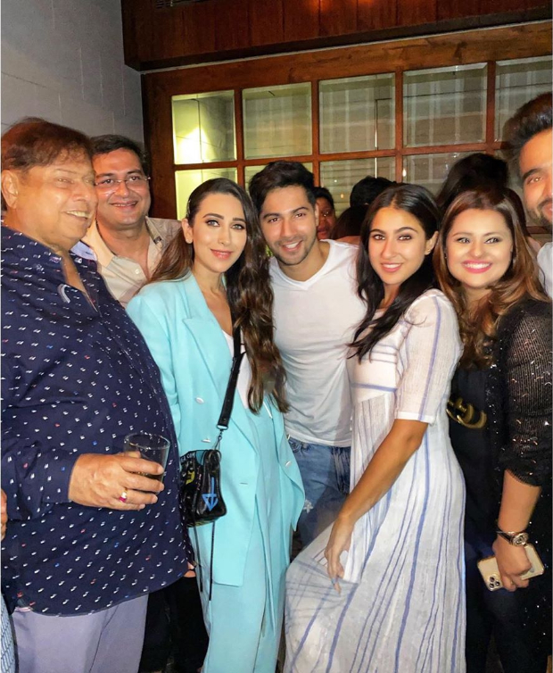 Varun Dhawan and Sara Ali Khan strike a pose with original Coolie No 1 girl Karisma Kapoor at wrap up party