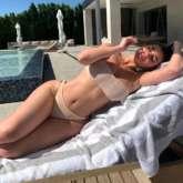 HOT! Kylie Jenner soaks in the sun flaunting her curves in beige bikini amid quarantine period