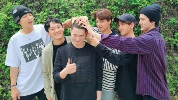 EXO members come together to support Suho as he enlists in military