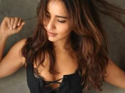 Neha Sharma sets the temperature soaring as she sizzles in a black monokoni