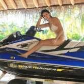 Throwback Thursday: Disha Patani looks smokin' hot in this tiny white bikini while posing on jet ski