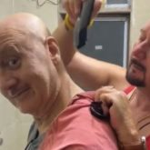 Watch: Anupam Kher gets the 'quickest haircut' from brother Raju Kher