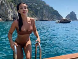 Amy Jackson stuns in brown two piece bikini whilst swimming in Capri