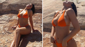 Kylie Jenner soaks in the sun in tiny orange bikini during her vacation at Canyon Point