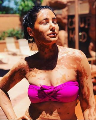 Nargis Fakhri soaks in the sun in pink bikini while enjoying mud bath