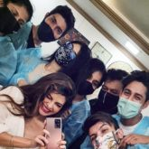Jacqueline Fernandez poses with her team as she resumes work