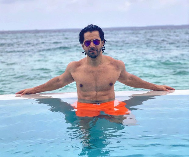 Varun Dhawan is chilling in the pool in Maldives flaunting his ab-tastic physique