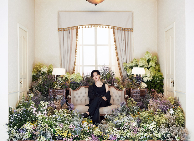 BTS drops second interactive concept photos that feature member Jimin surrounded by a room full of flowers