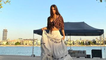 Shah Rukh Khan's daughter Suhana Khan poses by the lake in a chic boho skirt with a knotted top
