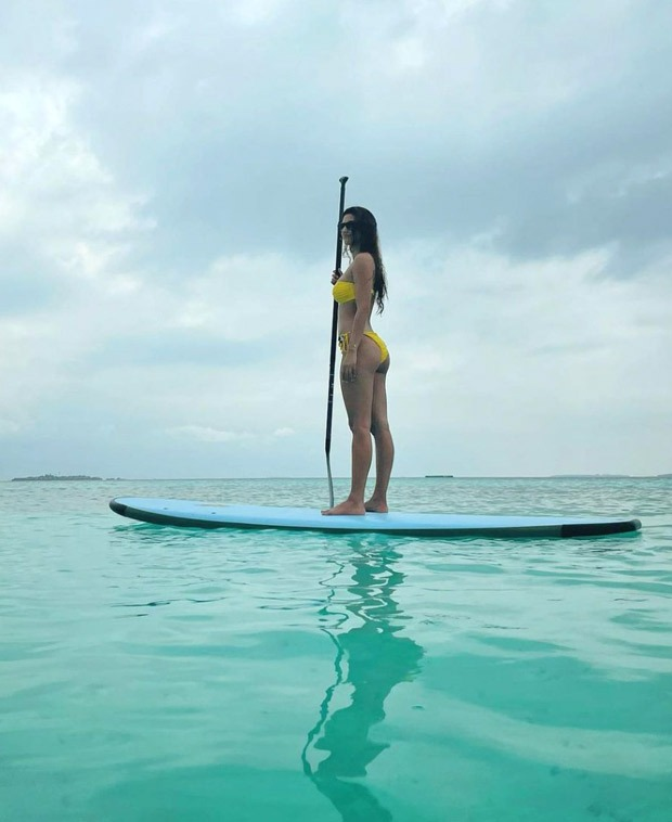 Disha Patani goes surfing, recreates the iconic Aquaman pose in a neon bikini