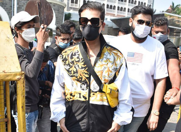 Karan Johar spotted at Gateway Of India, leaving for Varun Dhawan-Natasha Dalal's wedding