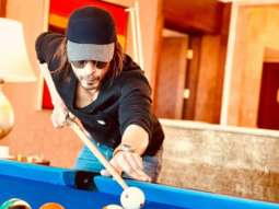 Shah Rukh Khan gives a glimpse of his Pathan look for the first time while playing a game of pool