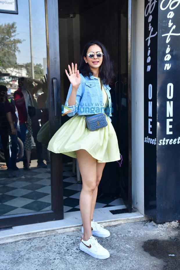 Rakul Preet Singh pairs yellow mini dress with denim jacket, Yves Saint Laurent bag worth Rs. 80,956 and Nike sneakers