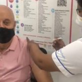 Anupam Kher takes the first dose of COVID-19 vaccination; shares video