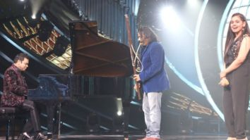 A.R Rahman plays piano during Shanmukhapriya's performance on Indian Idol Season 12