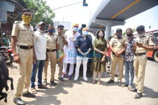 Photos: Mika Singh, Vindu Dara Singh and Bhoomi Trivedi snapped distributing food to needy people at Goregaon