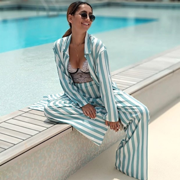Anusha Dandekar adds oomph to her look, pairs a striped pantsuit with lacy bustier