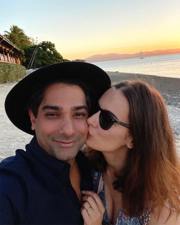 Evelyn Sharma gives a sweet kiss to her husband Tushaan Bhindi whilst on their honeymoon