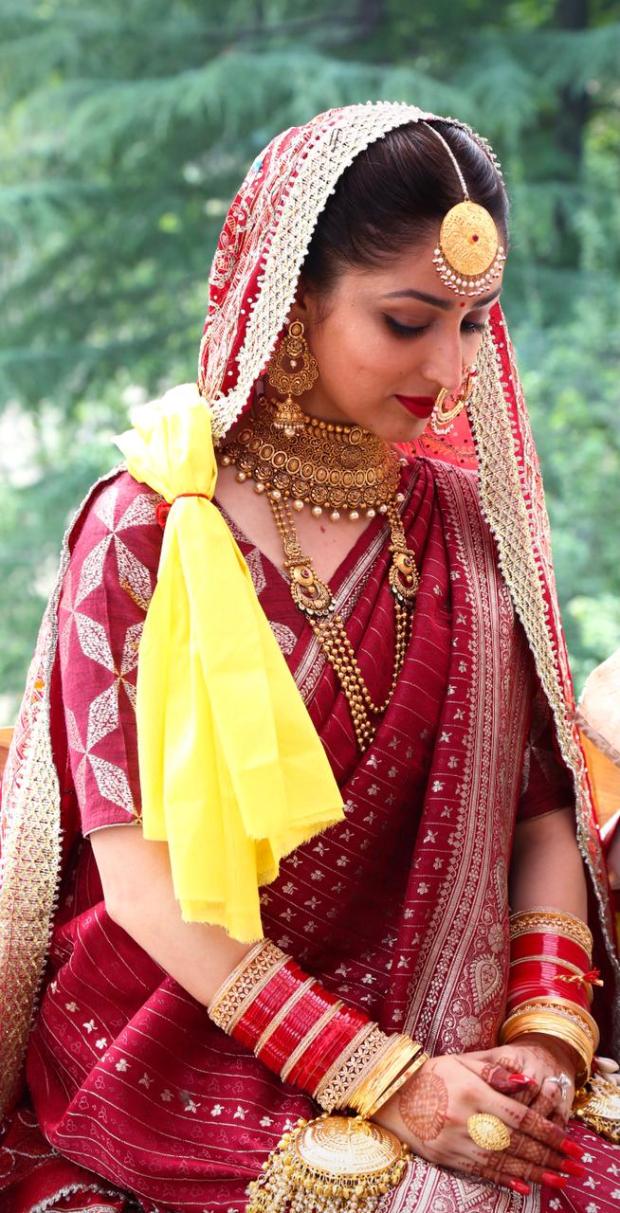 Yami Gautam wore her mother's 33-year-old traditional maroon silk sari at her wedding