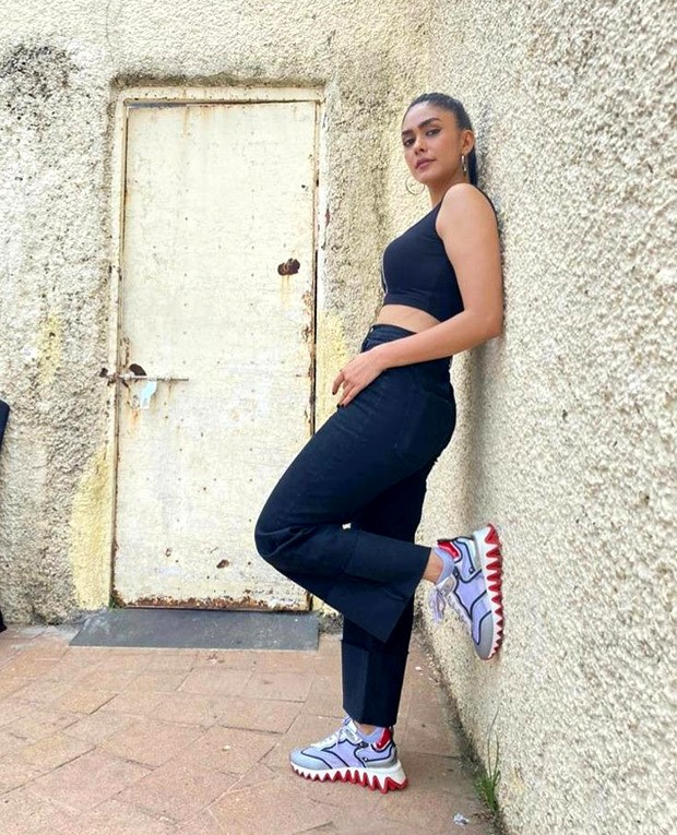 For Toofan promotions, Mrunal Thakur pairs crop top and flared denims with Christian Louboutin sneakers worth Rs. 62,795