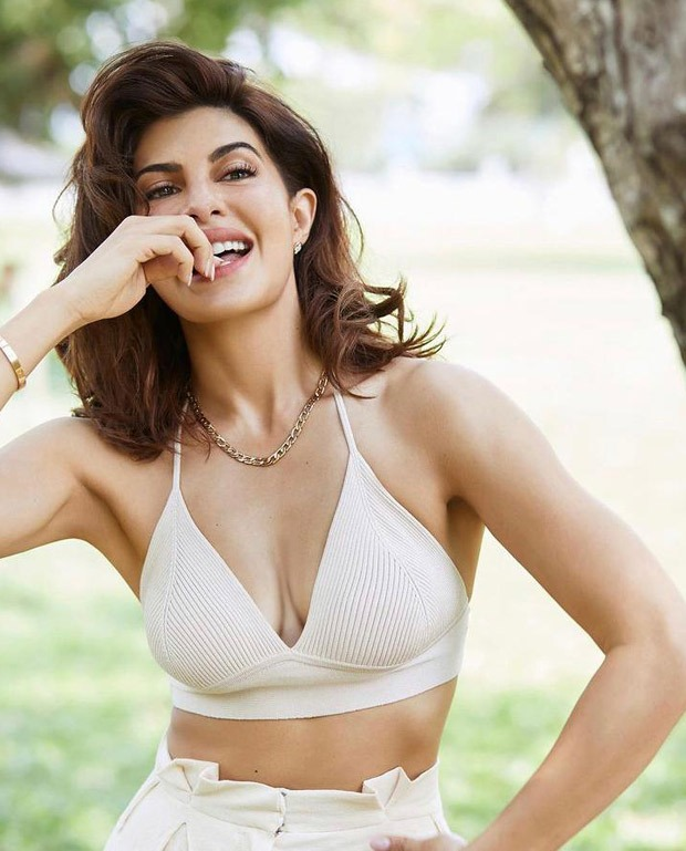 Jacqueline Fernandez looks alluring in white plunging neckline crop top and trousers