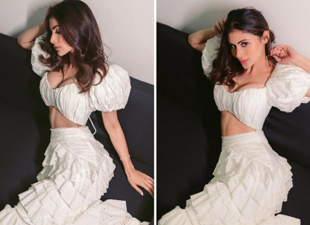 Mouni Roy is a vision in all white, dons balloon sleeve crop top and high-waisted ruffled skirt