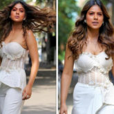 Nia Sharma opts for regencycore fashion, dons strapless sheer corset and white pants