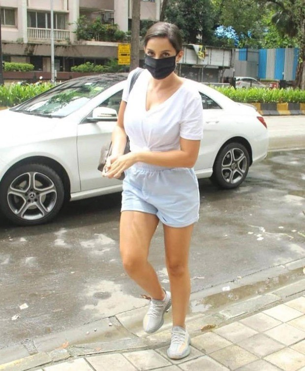 Nora Fatehi runs errands in knotted top and powder blue shorts; carries Louis Vuitton mini backpack worth Rs. 1.45 lakh