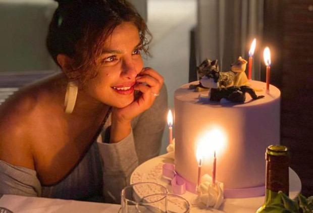 Priyanka Chopra enjoys sunny London weather in red plunging neckline swimsuit as Nick Jonas organises birthday party